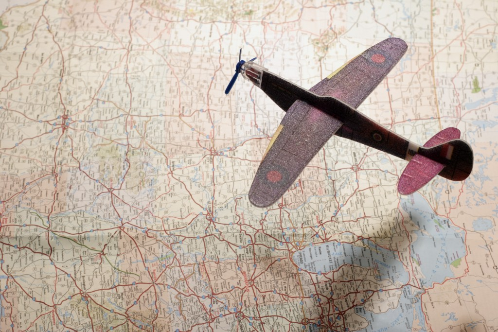 Model Airplane Over Map with Shadow